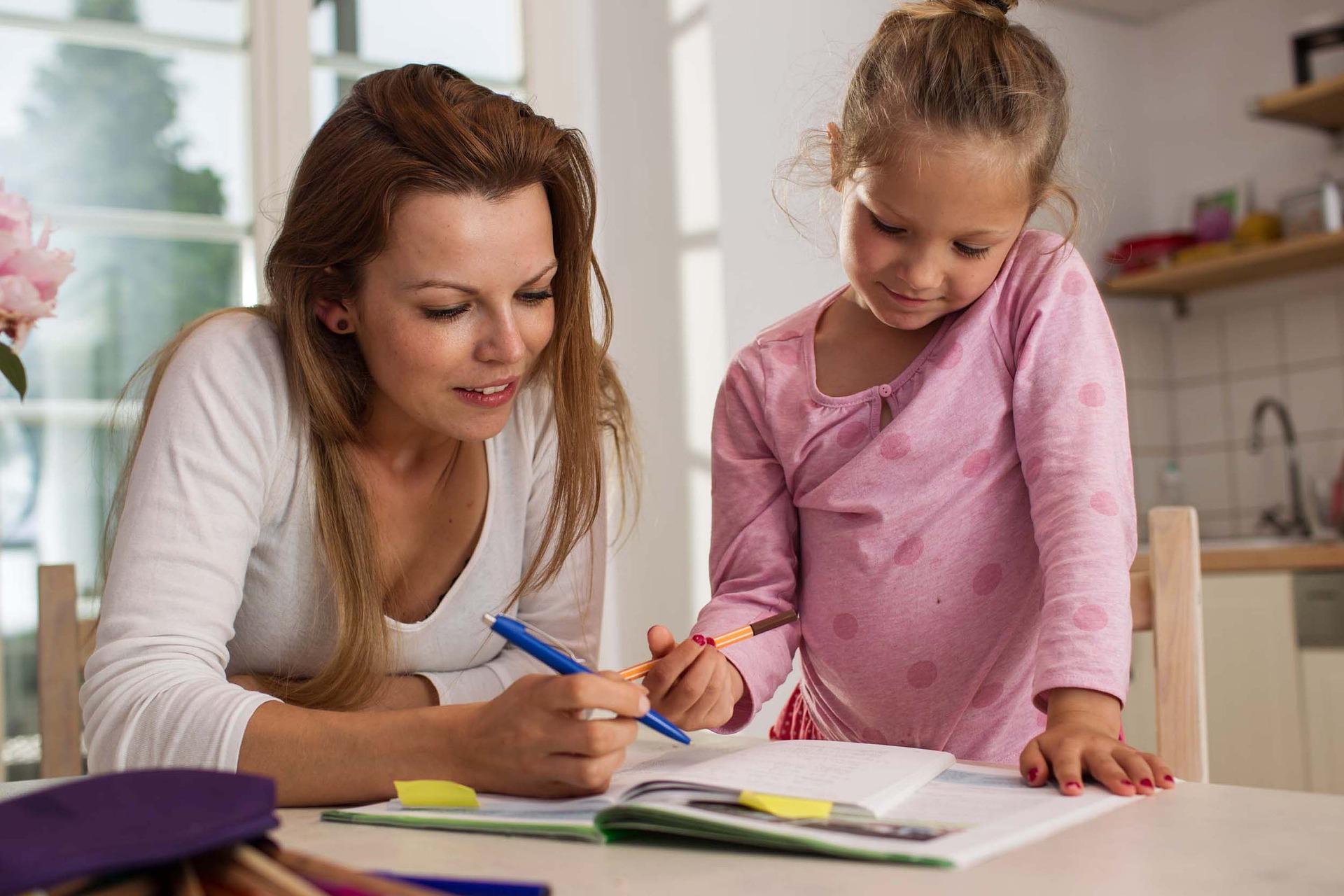woman doing school work with kids